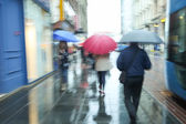Motion of people with umbrella — Stock Photo