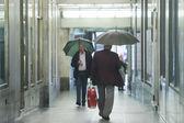 Senior adults walking in passage — Stockfoto