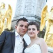 Newlyweds posing in front of fountain — Stock Photo #81158116