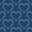 Blue seamless pattern with hearts made of snowflakes. — Stock Vector #54831221