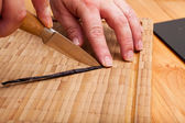 Cutting open the vanilla pod with a knife — Stock Photo