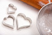 Cookie cutters and flour sieve — Stock Photo