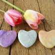 Three stone hearts and two tulips — Stock Photo #72934405