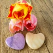 Three tulips and two stone hearts — Stock Photo #72934417