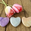 Three stone hearts and two tulips — Stock Photo #72934421