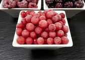 Bowls with three kinds of frozen berries — Foto Stock