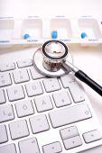 Stethoscope, pill box and keyboard — Stock Photo