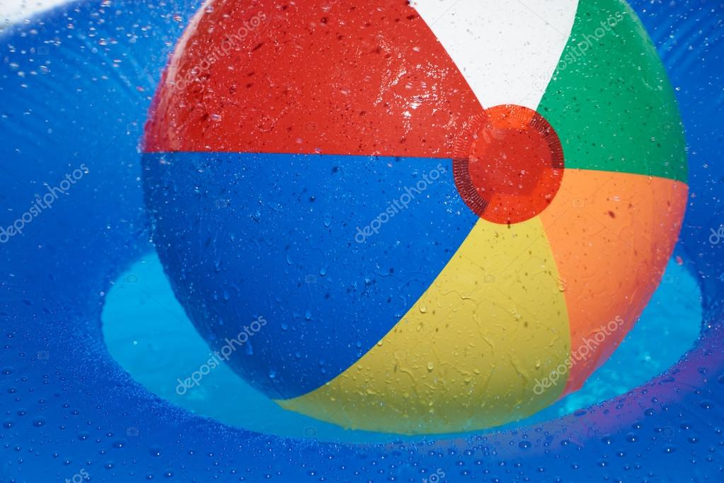 Pool Water With Beach Ball floating tire and beach ball in the pool — stock photo