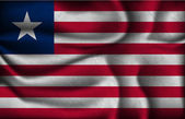 Crumpled flag of Liberia on a light background — Stockvector