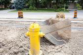Excavator scoop on construction site — Stock Photo
