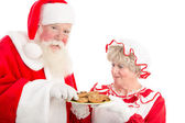Santa and Mrs Claus with plate of cookies — Stock Photo