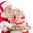 Santa steals a cookie — Stock Photo #60493845