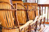 Rustic rockers in a row — Stock Photo