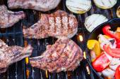 Grilled pork chops on BBQ — Stock Photo
