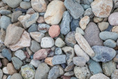 Natural rock pebble backgorund — Stock Photo