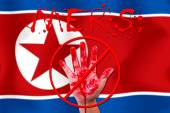 Concept show hand stop MERS Virus epidemic  North Korea flag bac — Stock Photo