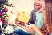 Couple with Christmas Gift — Stock Photo