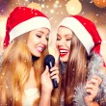 Girls in santa hats singing — Stock Photo #60807783