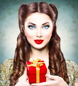 Girl with holiday gift box — Stock Photo