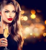 Girl with glass of champagne — Stock Photo
