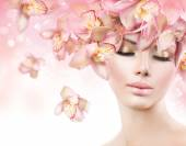 Girl with Orchid Flowers Hair — Stock Photo