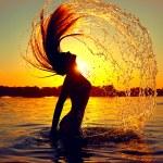 Girl splashing water with her hair — Stock Photo #61540219