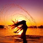 Girl splashing water — Stock Photo #61540969