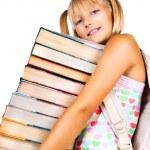 Schoolgirl with stack of books. — Stock Photo #61541347