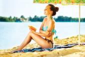 Woman Applying Sunscreen Cream — Stock Photo