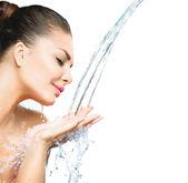 Girl with splashes — Stock Photo