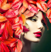 Autumn Woman with autumn leaves — Stock Photo