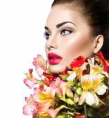 Girl with colorful flowers — Stock Photo