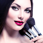 Woman with Makeup Brushes. — Stock Photo