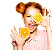 Joyful teen girl with oranges — Stock Photo