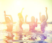 Girls playing at the beach — Stock Photo
