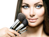 Girl with Makeup Brushes. — Stock Photo