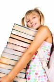 Schoolgirl with stack of books. — Stock Photo