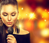 Singing Woman with Microphone — Stock Photo