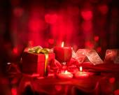 Valentine red  candles and gift — Stock Photo