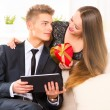 Woman giving  gift to her boyfriend — Stock Photo #74136695
