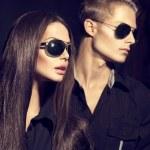 Fashion models couple wearing sunglasses — Stock Photo #74136705