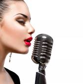 Singing woman with retro microphone. — Stock Photo