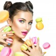 Model girl taking colorful macaroons — Stock Photo #74140045