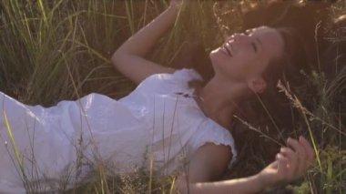 Beauty girl outdoors. Enjoying nature — Stock Video