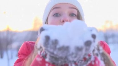 Girl blowing snow  outdoors — Stock Video