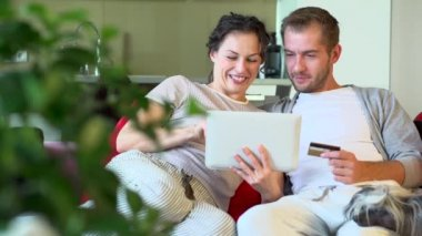 Couple Using  Wireless Tablet and Credit Card — Stock Video