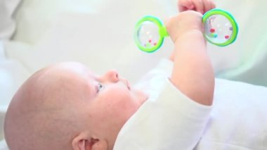 Baby boy playing with  rattle toy. — Stock Video