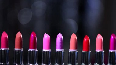 Lipsticks blinking bokeh background. — Stock Video