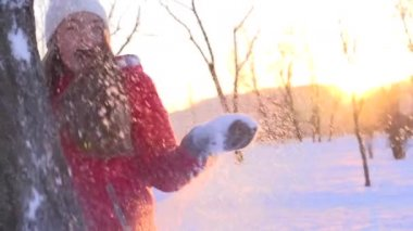 Joyful girl throwing snow — Stock Video