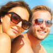 Happy couple having fun on beach — Stock Photo #80035608